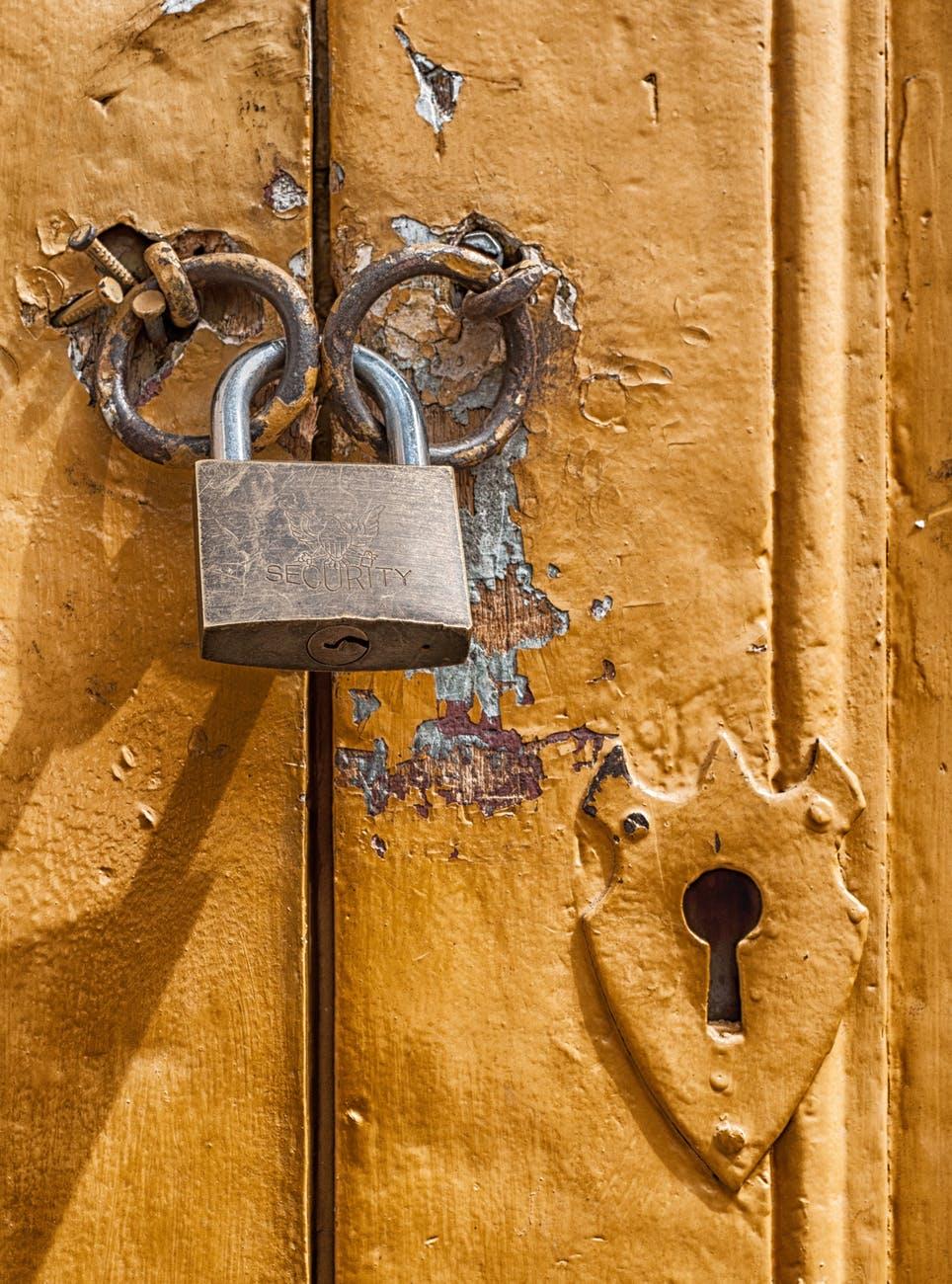 close up door golden keyhole